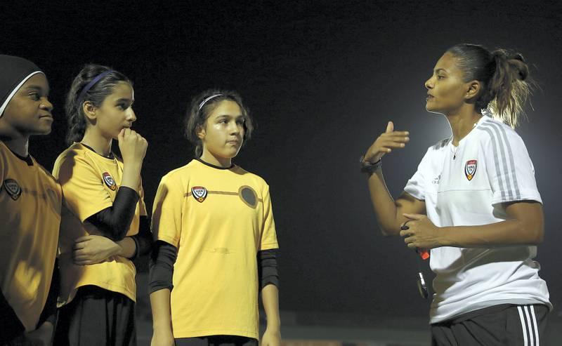 Dubai, 02, Nov, 2017: Houriya Al Tahri, coach of the senior women's national football team talks to the U-15 team during the trainning session at the UAE Football Federation  in Dubai. Satish Kumar for the National / Story by Caline Malek