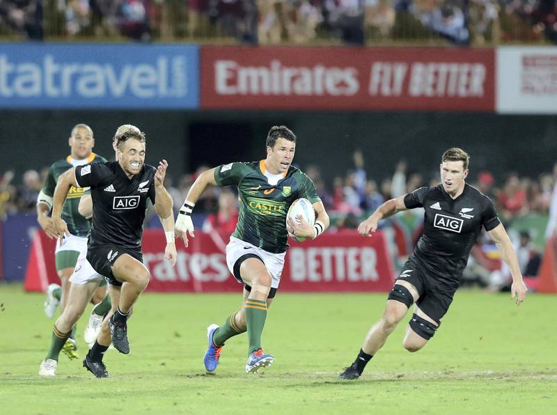 Dubai, United Arab Emirates - December 07, 2019: Ruhan Nel of New Zealand goes on a run during the game between New Zealand and South Africa in the mens final at the HSBC rugby sevens series 2020. Saturday, December 7th, 2019. The Sevens, Dubai. Chris Whiteoak / The National