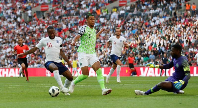 Soccer Football - International Friendly - England vs Nigeria - Wembley Stadium, London, Britain - June 2, 2018   England's Raheem Sterling in action with Nigeria's William Troost-Ekong                Action Images via Reuters/Carl Recine