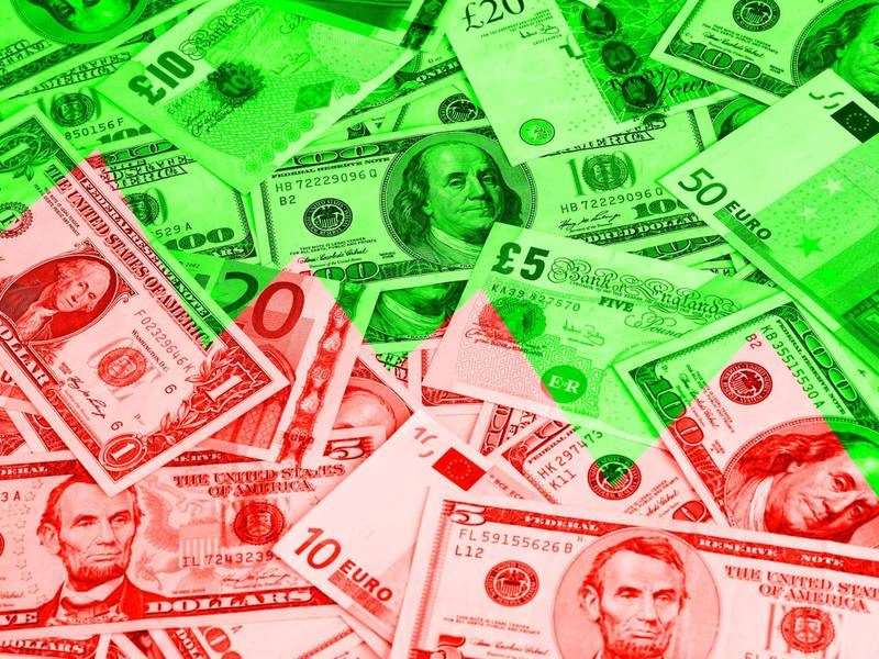 Different currencies shot full frame. There are euros, dollars and pounds on this photograph, shot in perspective. Studio shot, horizontal frame.