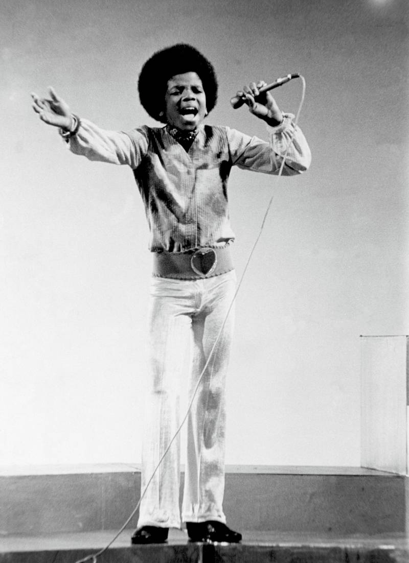 """CIRCA 1970:  Pop singer Michael Jackson of the R&B quintet """"Jackson 5"""" performs onstage in circa 1970. (Photo by Michael Ochs Archives/Getty Images)"""