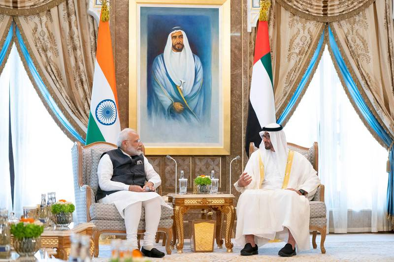 ABU DHABI, UNITED ARAB EMIRATES - August 24, 2019: HH Sheikh Mohamed bin Zayed Al Nahyan, Crown Prince of Abu Dhabi and Deputy Supreme Commander of the UAE Armed Forces (R), meets with HE Narendra Modi Prime Minister of India (L), at Qasr Al Watan.  ( Ryan Carter / Ministry of Presidential Affairs ) ---