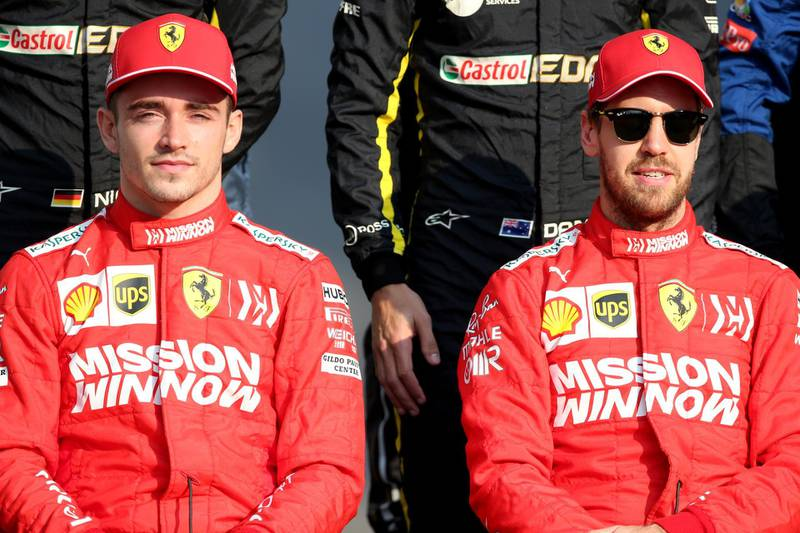 ABU DHABI, UNITED ARAB EMIRATES - DECEMBER 01: Charles Leclerc of Monaco and Ferrari and Sebastian Vettel of Germany and Ferrari  sit for the F1 Drivers Class of 2019 photo before the F1 Grand Prix of Abu Dhabi at Yas Marina Circuit on December 01, 2019 in Abu Dhabi, United Arab Emirates. (Photo by Charles Coates/Getty Images)