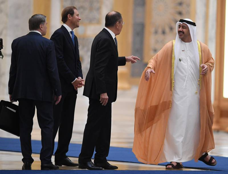 Russian Foreign Minister Sergei Lavrov (2nd R) speaks to his Emirati counterpart, Sheikh Abdullah bin Zayed al-Nahyan (R), during a visit by Russia's president to the United Arab Emirates at Abu Dhabi's Al-Watan presidential palace on October 15, 2019.  Russian President Vladimir Putin is on an official visit to the UAE after Saudi Arabia, seeking to attract over $1.3 billion worth of investments in Russia's economy. / AFP / KARIM SAHIB