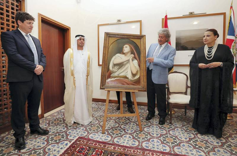 Abu Dhabi, United Arab Emirates - July 18, 2019: Presentation of the Masterpiece Mary Magdalene in Ecstasy, painted by Ary Scheffer, to Dr Hamed Bin Mohamed Khalifa Al Suwaidi, Chairman of Abu Dhabi Arts Society by Alan Lubin (R), President Emeritus of Five Islands Capital Limited of London, as a Loan in Perpetuity to the Emirate of Abu Dhabi, on behalf of the Lubin Family Art Collection Privé. Her Majesty's Ambassador from UK to UAE Patrick Moody (L) and Her Excellency Huda Kanoo, founder of Abu Dhabi Music and Arts Foundation. Thursday the 18th of July 2019. British Embassy, Abu Dhabi. Chris Whiteoak / The National