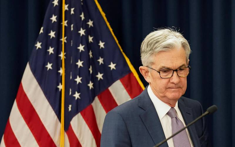 FILE PHOTO: U.S. Federal Reserve Chairman Jerome Powellarrives to speak to reporters afterthe Federal Reserve cut interest rates in an emergency move designed to shield the world's largest economy from the impact of the coronavirus, in Washington, U.S., March 3, 2020. REUTERS/Kevin Lamarque/File Photo