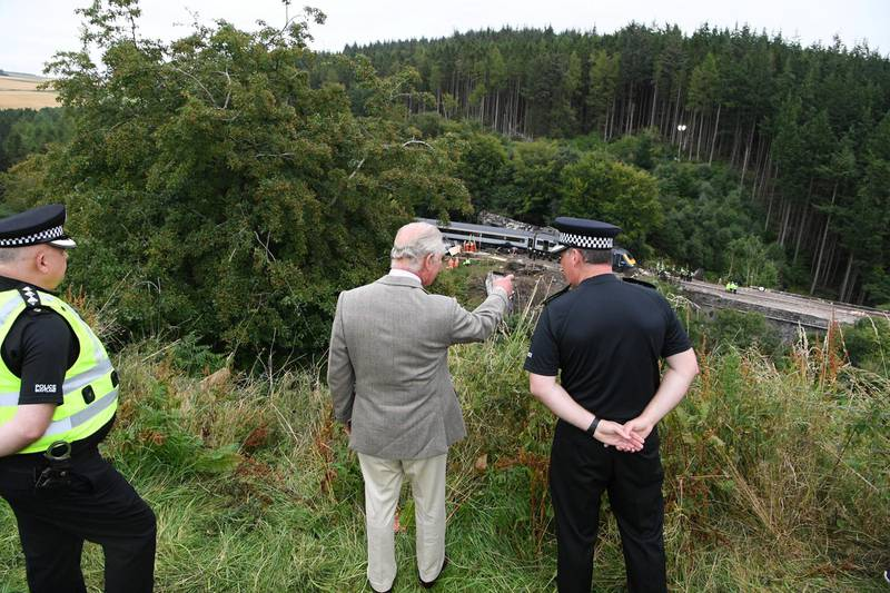 STONEHAVEN, SCOTLAND - AUGUST 14:  Prince Charles, Prince of Wales looks over at the scene of the ScotRail train derailment near Stonehaven, Aberdeenshire, which cost the lives of three people people on August 14, 2020 in Stonehaven, Scotland. Prince Charles, known as the Duke of Rothesay while in Scotland, visited the site to thank those who were among the first on the scene. (Photo by Ben Birchall - WPA Pool/Getty Images)