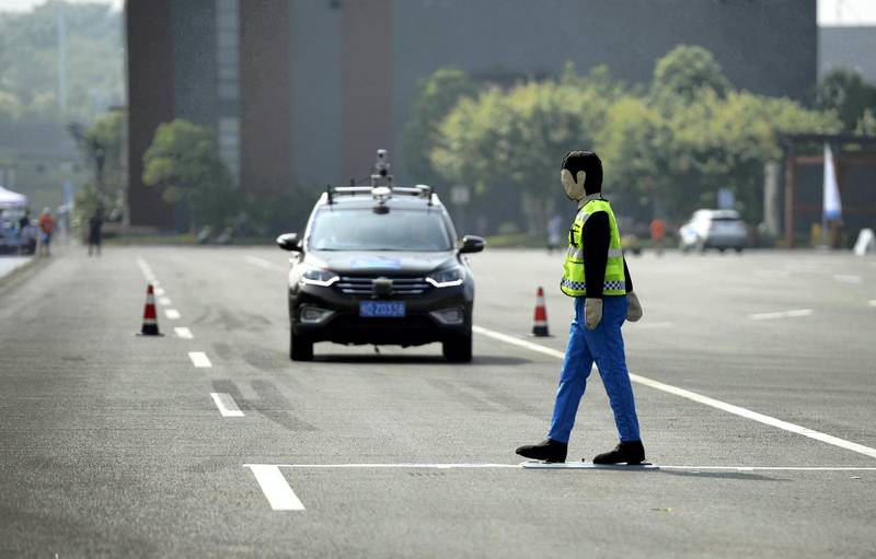 CHONGQING, CHINA - AUGUST 18: An unmanned automobile competes in the i-VISTA (Intelligent Vehicle Integrated Systems Test Area) Autonomous Driving Challenge on August 18, 2018 in Chongqing, China. The Intelligent Vehicle Integrated Systems Test Area (i-VISTA) in Chongqing provided a simulated city environment for over 20 teams to compete in two aspects including APS challenge and AEB challenge. (Photo by VCG/VCG via Getty Images)