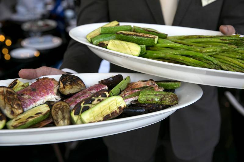 ABU DHABI, UNITED ARAB EMIRATES, Mar. 28, 2015:   Wood-owen grilled vegetables and Sultan Ibrahim, a locally caught fish, and asparagus, all seasoned with olive oil and lemon juice only, are served at the #healthyliving cooking experience, organized by The National, on Saturday, Mar. 28, 2015, at the Le Royal Meridian hotel in downtown Abu Dhabi. (Silvia Razgova / The National)  (Usage: undated, #healthyliving Section: Healthy living mag, Reporter: Stacie Johnson) *** Local Caption ***  SR-150328-cooking58.jpg