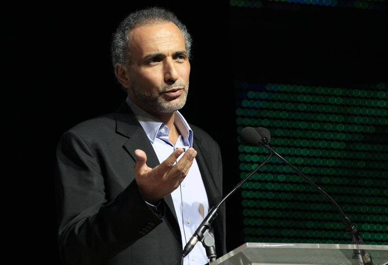 """(FILES) In this file photo taken on April 07, 2012 shows Swiss Muslim intellectual and professor Tariq Ramadan speaking during a meeting focused on """"Faith and Resistance, Reform and Expectancy"""" at the yearly meeting of French Muslims organized by the Union of Islamic Organisations of France (UOIF) in Le Bourget, outside Paris. Reformist scholar Ramadan, already charged with two counts of rape with a third rape accusation emerging in March of 2018, is facing a new complaint in France, for a rape that allegedly took place in 2014, and which could lead to further prosecution. / AFP / Jacques DEMARTHON"""