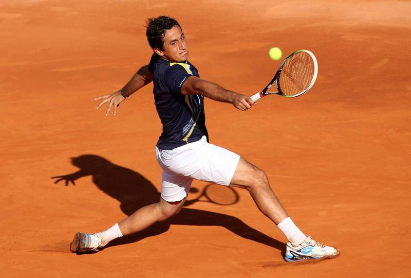 BARCELONA, SPAIN - APRIL 25: Nicolas Almagro of Spain in action against Rafael Nadal of Spain during day five of the ATP Tour Open Banc Sabadell Barcelona 2014, 62nd Trofeo Conde de Godo at Real Club de Tenis Barcelona on April 25, 2014 in Barcelona, Spain. (Photo by Jean Catuffe/Getty Images)