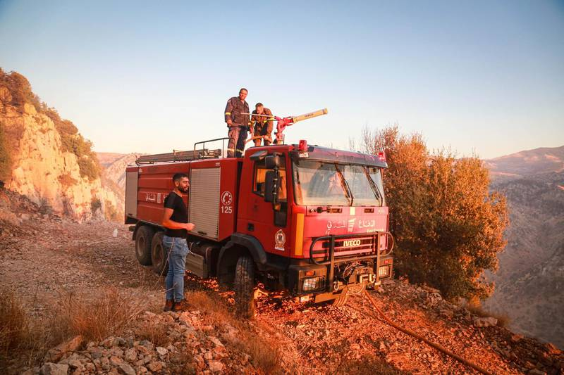 A firetruck from the Lebanese Civil Defense arrives to put out fires in in Jird Meshmesh, in Lebanon's Akkar region on Aug. 24, 2020