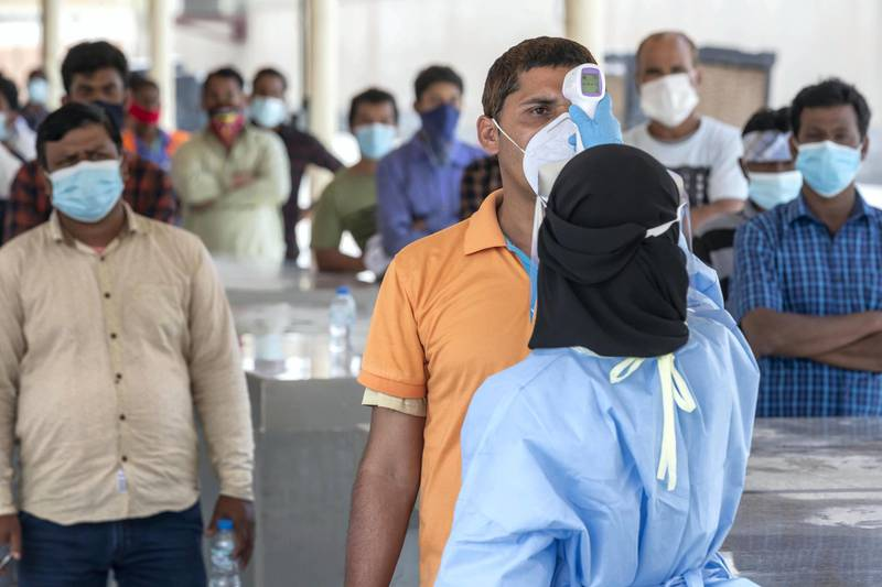 ABU DHABI, UNITED ARAB EMIRATES. 16 APRIL 2020. COVID-19 Testing station in Al Mussafah. a pre temperature. check as individuals wait in line to possibly be tested.  (Photo: Antonie Robertson/The National) Journalist: Haneen Dajani. Section: National.