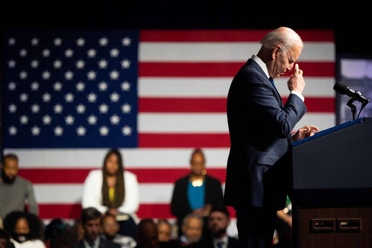 TOPSHOT - TULSA, OKLAHOMA - JUNE 01: U.S. President Joe Biden silently prays during a moment of silence during commemorations of the 100th anniversary of the Tulsa Race Massacre on June 01, 2021 in Tulsa, Oklahoma. President Biden stopped in Tulsa to commemorate the centennial of the Tulsa Race Massacre. May 31st of this year marks the centennial of when a white mob started looting, burning and murdering in Tulsa's Greenwood neighborhood, then known as Black Wall Street, killing up to 300 people and displacing thousands more. Organizations and communities around Tulsa continue to honor and commemorate survivors and community residents.   Brandon Bell/Getty Images/AFP / AFP / GETTY IMAGES NORTH AMERICA / Brandon Bell