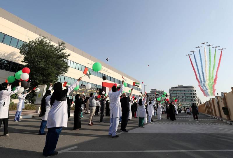 Dubai, United Arab Emirates - Reporter: N/A. News. Fursan Al Emarat, the UAE Air Force's aerobatic display team fly over Al Kuwait Hospital in Dubai. Tuesday, June 23nd, 2020. Dubai. Chris Whiteoak / The National