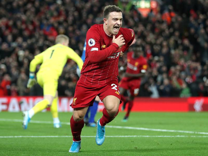"""Liverpool's Xherdan Shaqiri celebrates scoring his side's second goal of the game during the Premier League match at Anfield, Liverpool. PA Photo. Picture date: Wednesday December 4, 2019. See PA story SOCCER Liverpool. Photo credit should read: Richard Sellers/PA Wire. RESTRICTIONS: EDITORIAL USE ONLY No use with unauthorised audio, video, data, fixture lists, club/league logos or """"live"""" services. Online in-match use limited to 120 images, no video emulation. No use in betting, games or single club/league/player publications."""