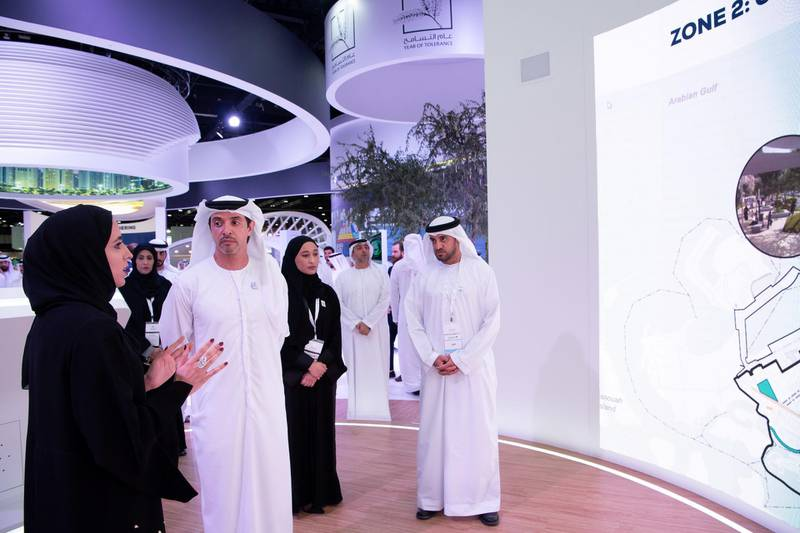ABU DHABI, UNITED ARAB EMIRATES - April 16, 2019: HH Sheikh Hazza bin Zayed Al Nahyan, Vice Chairman of the Abu Dhabi Executive Council (2nd L), attends the opening of Cityscape Abu Dhabi, at Abu Dhabi National Exhibition Centre (ADNEC). Seen with HE Falah Mohamed Al Ahbabi, Chairman of the Department of Urban Planning and Municipalities, and Abu Dhabi Executive Council Member (R).   (  Saeed Al Neyadi / Ministry of Presidential Affairs ) ---
