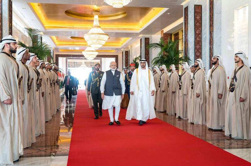 """A handout image provided by the United Arab Emirates News Agency (WAM) on August 24, 2019,  shows Mohamed bin Zayed al-Nahyan (R), Crown Prince of Abu Dhabi and Deputy Supreme Commander of the UAE Armed Forces (R) and Indian Prime Minister Narendra Modi (L), reviewing honour guard in the UAE capital. === RESTRICTED TO EDITORIAL USE - MANDATORY CREDIT """"AFP PHOTO / HO / WAM"""" - NO MARKETING NO ADVERTISING CAMPAIGNS - DISTRIBUTED AS A SERVICE TO CLIENTS ===  / AFP / WAM / STRINGER / === RESTRICTED TO EDITORIAL USE - MANDATORY CREDIT """"AFP PHOTO / HO / WAM"""" - NO MARKETING NO ADVERTISING CAMPAIGNS - DISTRIBUTED AS A SERVICE TO CLIENTS ==="""