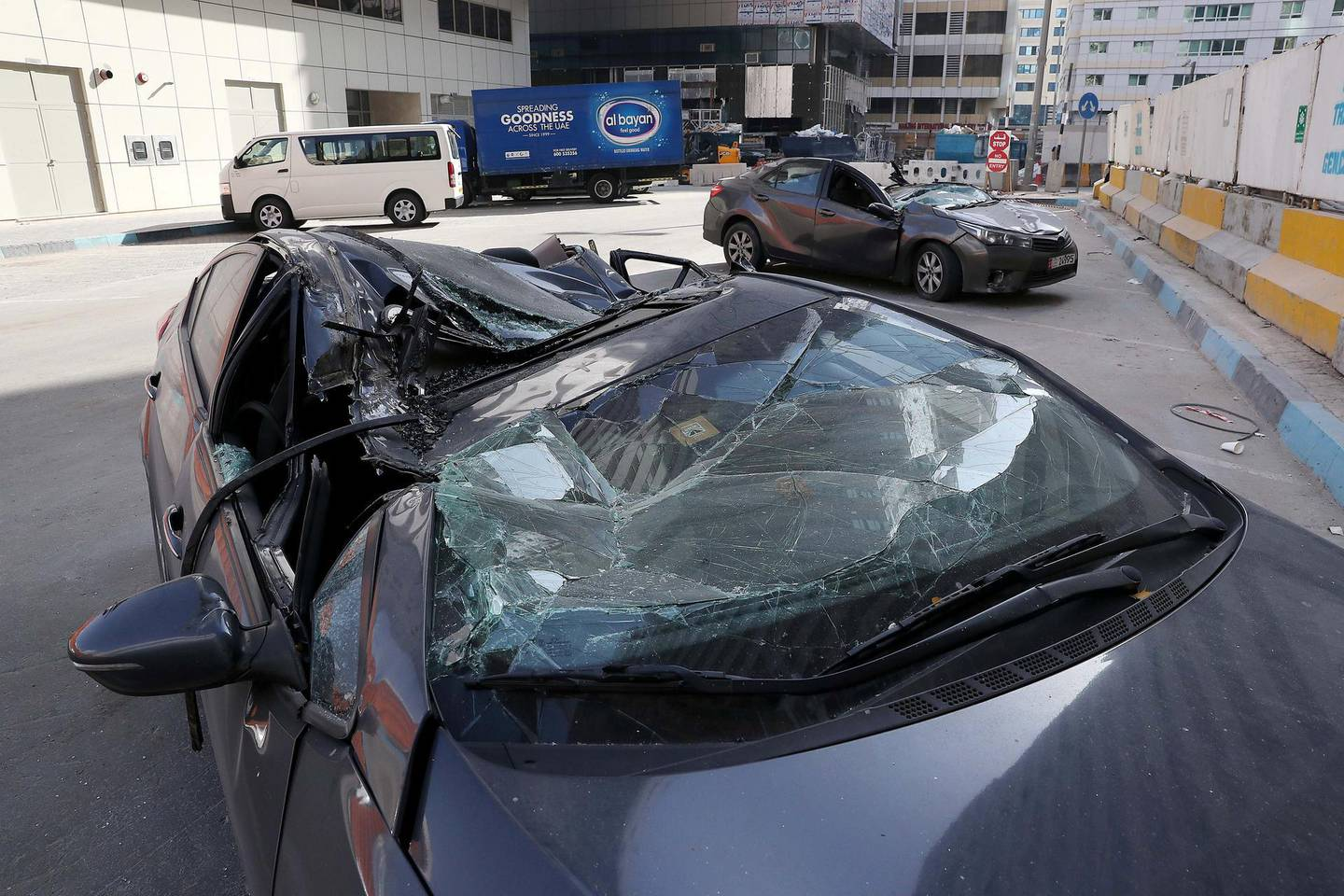 ABU DHABI , UNITED ARAB EMIRATES , MARCH 27  – 2018 :- Two cars damaged after crane at the construction site fell on them yesterday near the Al Salama hospital in Abu Dhabi. ( Pawan Singh / The National ) For News. Story by John