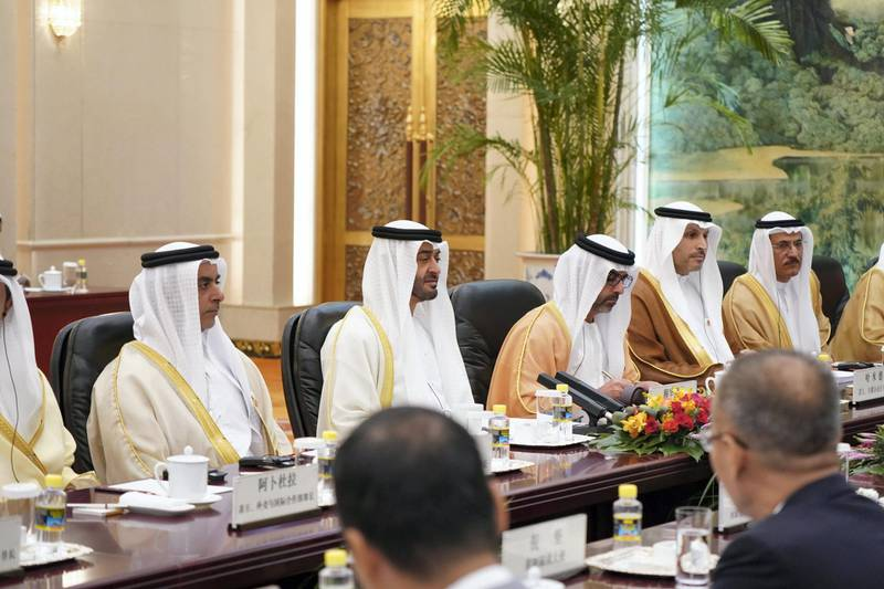 BEIJING, CHINA - July 22, 2019: HH Sheikh Mohamed bin Zayed Al Nahyan, Crown Prince of Abu Dhabi and Deputy Supreme Commander of the UAE Armed Forces (2nd L), meets with HE Li Keqiang, Premier of the State Council of China (not shown), at the Great Hall of the People. Seen with HH Lt General Sheikh Saif bin Zayed Al Nahyan, UAE Deputy Prime Minister and Minister of Interior (L), HH Sheikh Hamed bin Zayed Al Nahyan, Chairman of the Crown Prince Court of Abu Dhabi and Abu Dhabi Executive Council Member (3rd L), HE Khaldoon Khalifa Al Mubarak, CEO and Managing Director Mubadala, Chairman of the Abu Dhabi Executive Affairs Authority and Abu Dhabi Executive Council Member (4th L) and HE Sultan bin Saeed Al Mansouri, UAE Minister of Economy (R).  ( Rashed Al Mansoori / Ministry of Presidential Affairs ) ---
