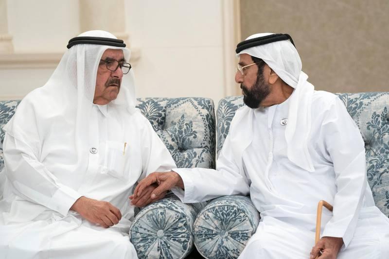 ABU DHABI, UNITED ARAB EMIRATES - November 21, 2019: HH Sheikh Hamdan bin Rashid Al Maktoum, Deputy Ruler of Dubai and UAE Minister of Finance (L), offers condolences to HH Sheikh Tahnoon bin Mohamed Al Nahyan, Ruler's Representative in Al Ain Region (R), on the passing of the late HH Sheikh Sultan bin Zayed Al Nahyan, at Al Mushrif Palace.  ( Hamad Al Mansoori for the Ministry of Presidential Affairs ) ---
