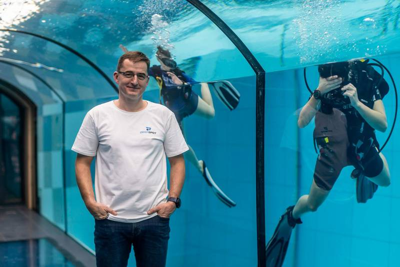 Deepspot director Michal Braszczynski poses at the deepest pool in the world with 45.5-metre (150-foot) located in Mszczonow about 50 km from Warsaw, November 21, 2020.  The complex, named Deepspot, even includes a small wreck for scuba and free divers to explore. It has 8,000 cubic metres of water -- more than 20 times the amount in an ordinary 25-metre pool.  / AFP / Wojtek RADWANSKI / TO GO WITH AFP STORY