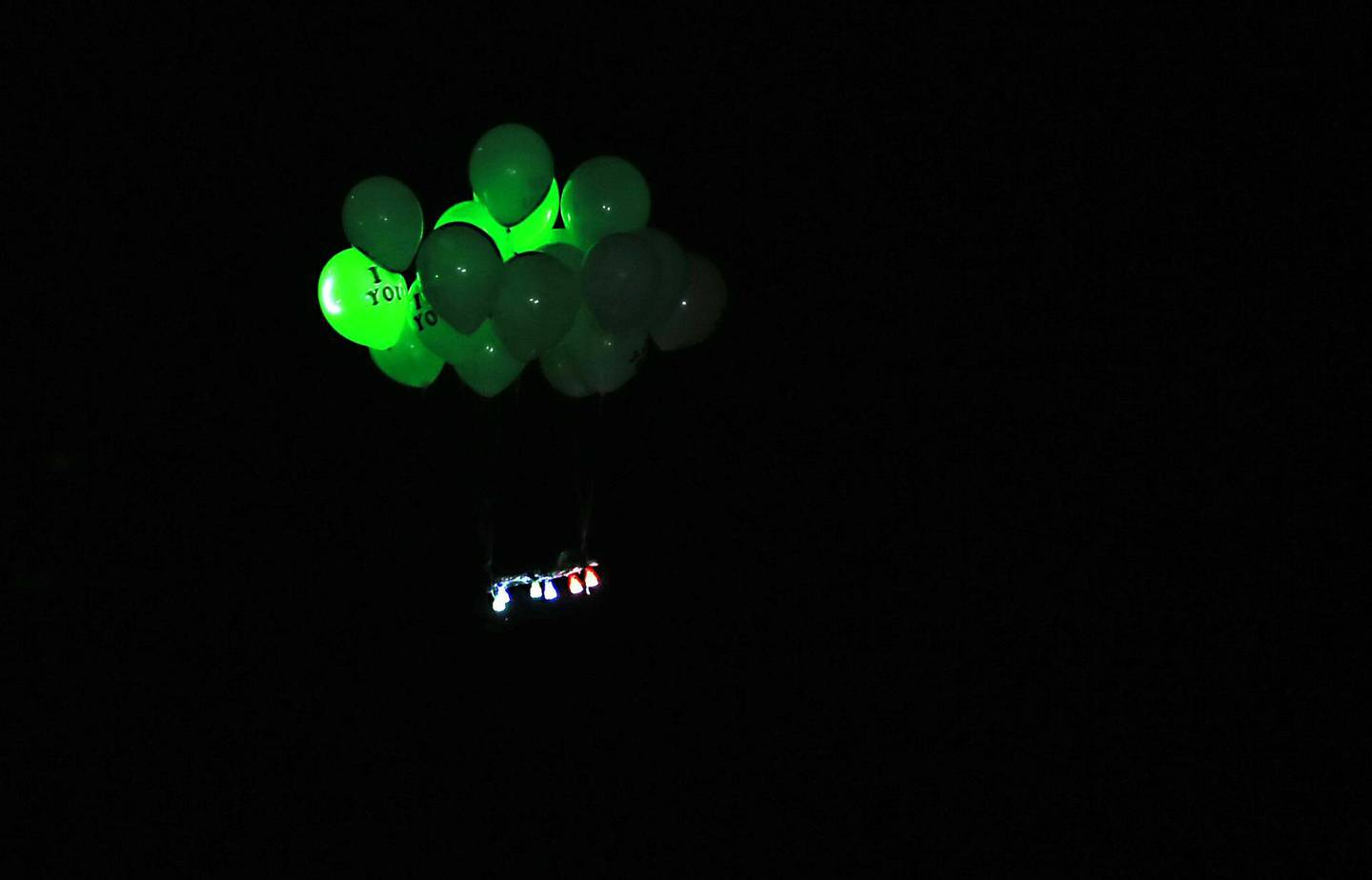 """Ballons attached with flammable materials launched by Palestinian protesters calling themselves the """"night confusion units"""" fly towards Israel, near the Gaza-Israel border east of Rafah in the southern Gaza Strip, on September 26, 2018. The border protests since March 30 have been labelled the """"Great March of Return"""" because they call for Palestinian refugees to return to their former homes inside what is now Israel. Hundreds of thousands of dollars in damage were caused to Israeli land -- including incinerated crops -- by the kites and balloons, Israeli authorities said. / AFP / SAID KHATIB"""