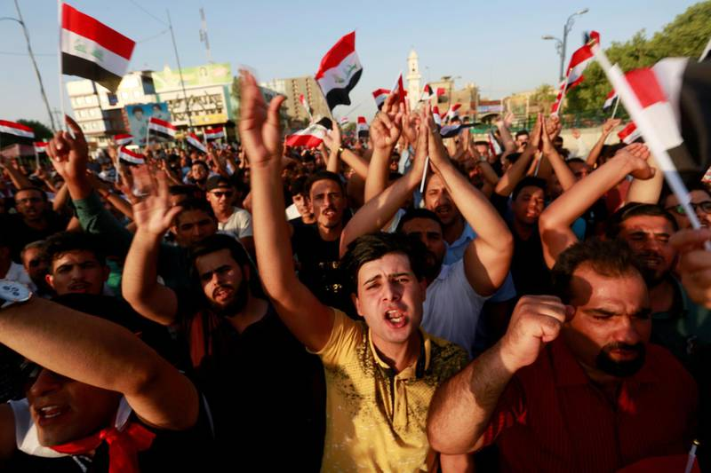 FILE PHOTO: People protest over poor public services in the city of Najaf, Iraq, July 27, 2018. REUTERS/Alaa al-Marjani/File Photo