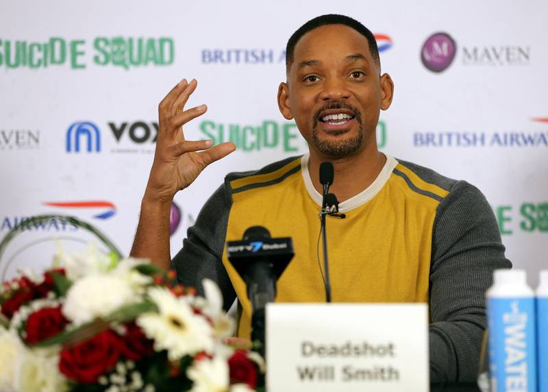 """Will Smith speaks at a press conference in Dubai, United Arab Emirates, on Sunday, Aug. 7, 2016. The American actor is in Dubai to promote the film """"Suicide Squad."""" (AP Photo/Adam Schreck)"""