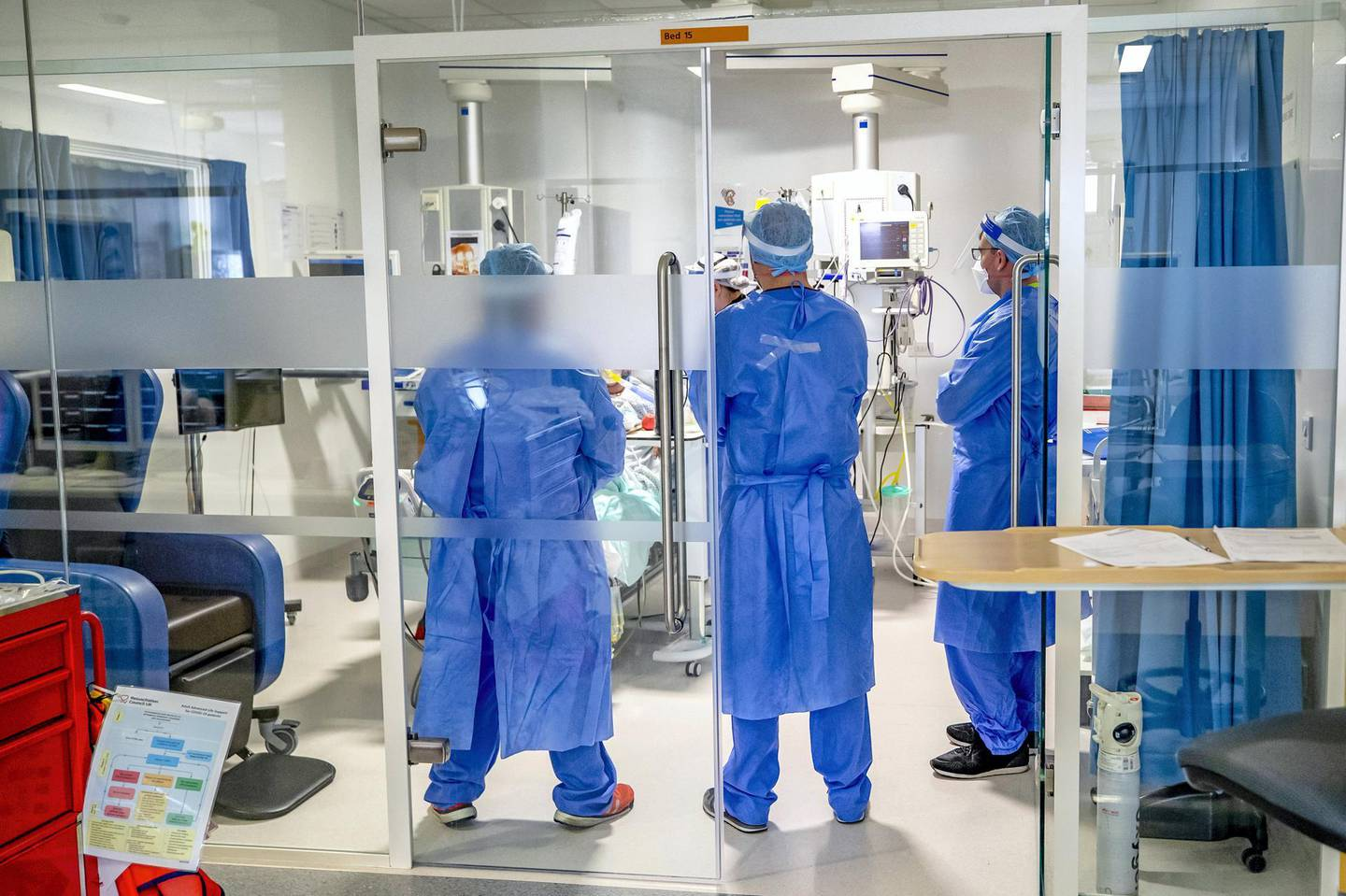 Health workers wearing full personal protective equipment (PPE) tend to a patient on the intensive care unit (ICU) at Whiston Hospital in Merseyside as they continue deal with the increasing number of coronavirus patients. (Photo by Peter Byrne/PA Images via Getty Images)