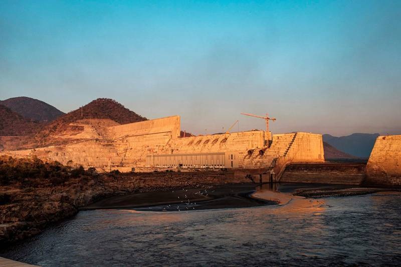 A general view of the the Grand Ethiopian Renaissance Dam (GERD), near Guba in Ethiopia, on December 26, 2019. The Grand Ethiopian Renaissance Dam, a 145-metre-high, 1.8-kilometre-long concrete colossus is set to become the largest hydropower plant in Africa. Across Ethiopia, poor farmers and rich businessmen alike eagerly await the more than 6,000 megawatts of electricity officials say it will ultimately provide.  Yet as thousands of workers toil day and night to finish the project, Ethiopian negotiators remain locked in talks over how the dam will affect downstream neighbours, principally Egypt. / AFP / EDUARDO SOTERAS