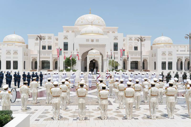 ABU DHABI, UNITED ARAB EMIRATES - April 29, 2018: HH Sheikh Mohamed bin Zayed Al Nahyan Crown Prince of Abu Dhabi Deputy Supreme Commander of the UAE Armed Forces and HE Sebastian Kurz, Chancellor of Austria, stand for the national anthem, during a reception held at the Presidential Palace.  ( Rashed Al Mansoori / Crown Prince Court - Abu Dhabi ) ---