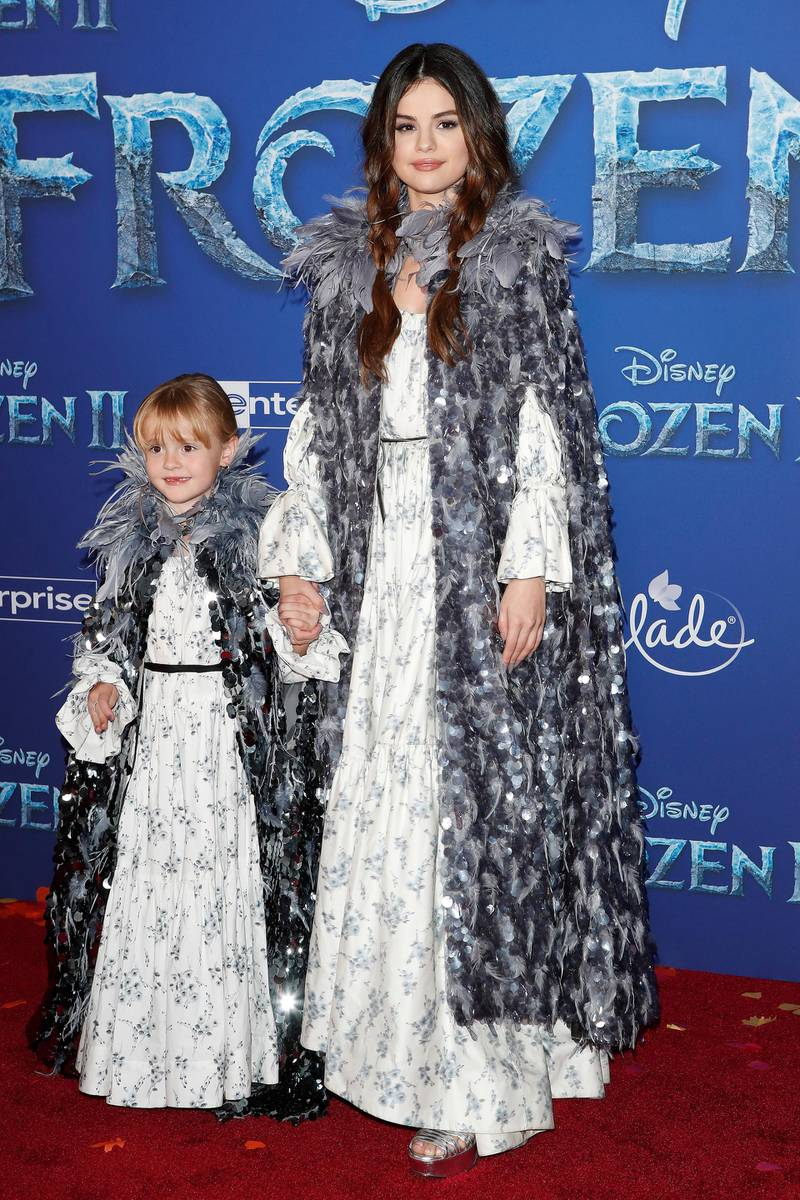 epa07980324 Media personality Gracie Elliot Teefey (L) and US singer Selena Gomez (R) pose on the red carpet prior to the world premiere of to movie 'Frozen II' at the Dolby Theatre in Hollywood, Los Angeles, California, USA, 07 November 2019. The movie is to be released in US theaters on 22 November 2019.  EPA-EFE/NINA PROMMER
