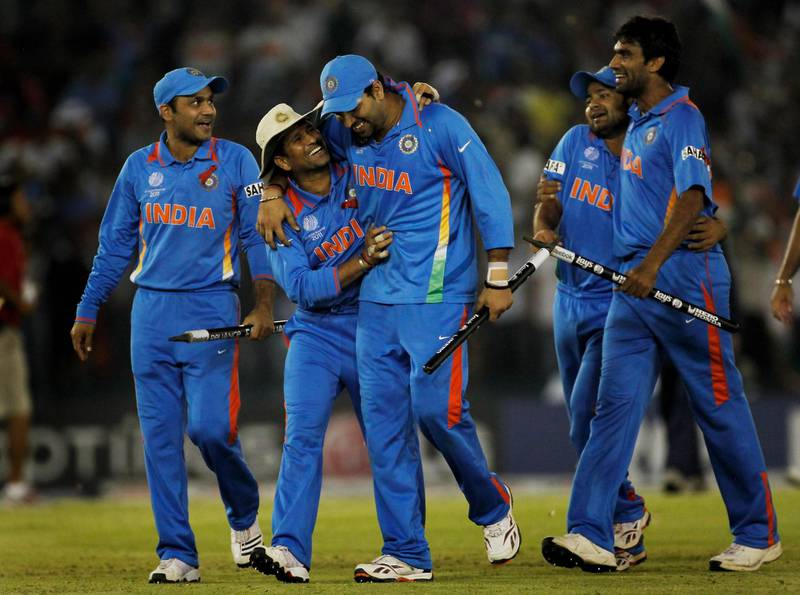 MOHALI, INDIA - MARCH 30:  The Indian team celebrate victory over Pakistan during the 2011 ICC World Cup second Semi-Final between India and Pakistan at Punjab Cricket Association (PCA) Stadium on March 30, 2011 in Mohali, India.  (Photo by Daniel Berehulak/Getty Images)