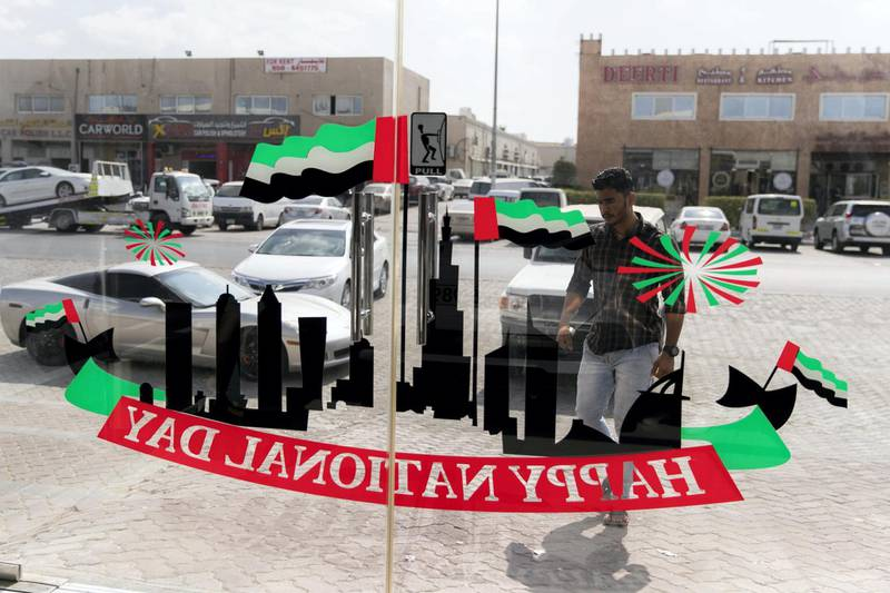 ABU DHABI, UNITED ARAB EMIRATES - NOVEMBER 27, 2018. Grand Plus Auto Accessories offers a variety of stickers and decorations to those celebrating National Day.Car accessory shops in Mussafah are keeping busy as motorists rush to dress up their vehicles ahead of the UAE's 47th National Day.(Photo by Reem Mohammed/The National)Reporter:  HANEEN DAJANISection:  NA