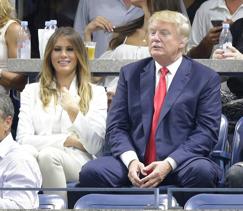 epa04921157 Republican presidential hopeful Donald Trump (R) and his wife Melania (L) watch as Venus Williams of the US plays Serena Williams of the US during their quarterfinals match on the ninth day of the 2015 US Open Tennis Championship at the USTA National Tennis Center in Flushing Meadows, New York, USA, 08 September 2015. The US Open runs through 13 September, which is a return to a 14-day schedule.  EPA/ANDREW GOMBERT