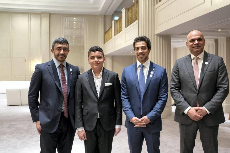 BERLIN, GERMANY - June 12, 2019: HH Sheikh Abdullah bin Zayed Al Nahyan UAE Minister of Foreign Affairs and International Cooperation (L) and HH Sheikh Mansour bin Zayed Al Nahyan, UAE Deputy Prime Minister and Minister of Presidential Affairs (2nd R), stand for a photograph with an Emirati student who is studying in Germany. Seen with Seen with HE Ali Abdullah Al Ahmed, UAE Ambassador to Germany (R).  (Eissa Al Hammadi / For the Ministry of Presidential Affairs )