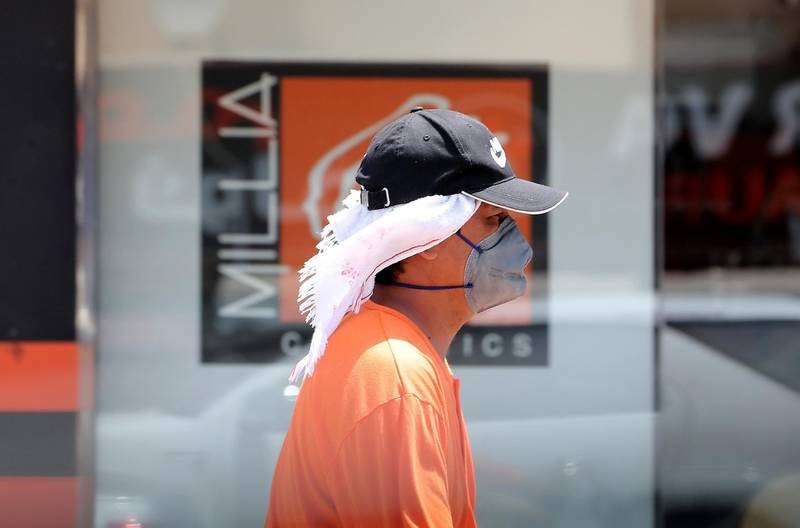 DUBAI, UNITED ARAB EMIRATES , June 11 – 2020 :- A person wearing protective face mask during the hot and humid weather in Al Satwa area in Dubai. (Pawan Singh / The National) For News/Standalone/Online/Stock