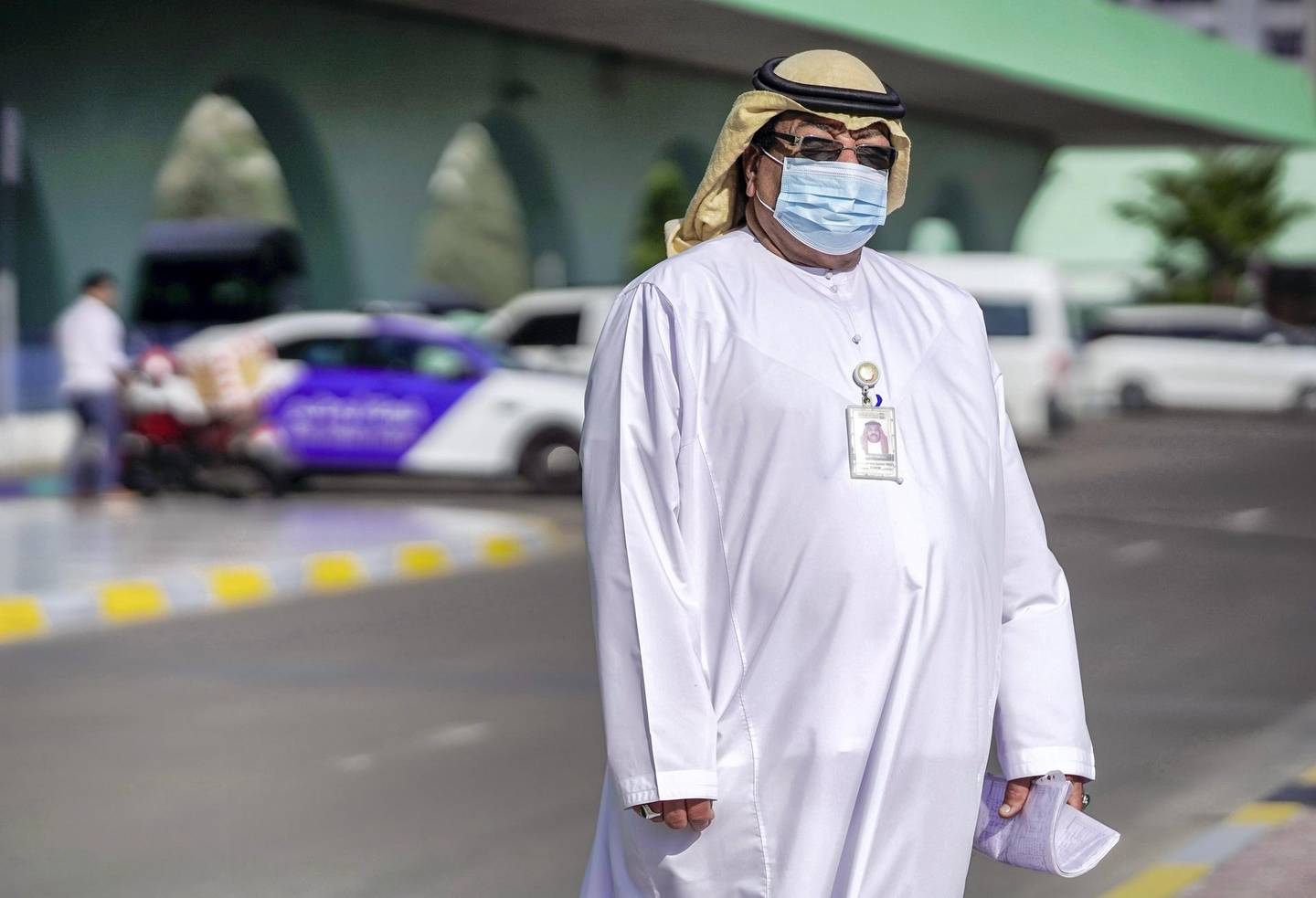 Abu Dhabi, United Arab Emirates, March 24, 2020. Standalone and Possible Photo Project: UAE Heroes of  Coronavirus--  Faisal Salih, Quality Control Officer at the Abu Dhabi Main Bus Terminal makes sure everything goes smoothly in spite of the ongoing coronavirus epidemic.  He is originally from Sudan and has been working at the AUH Central Bus Terminal for 20 years now.Victor Besa / The National