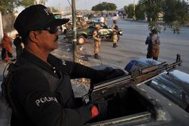 Three Pakistan police killed in clashes with banned group