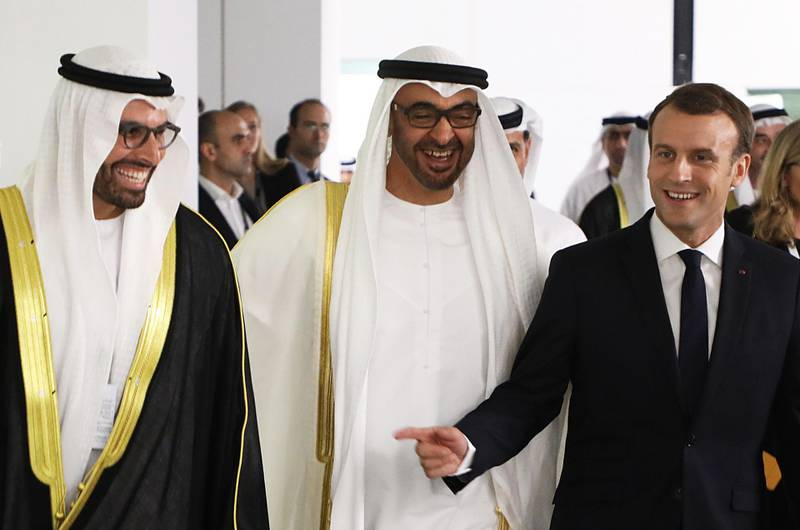 (From L to R) Chairman of Abu Dhabi's Tourism and Culture Authority, Mohamad Khalifa al-Mubarak, Abu Dhabi Crown Prince Mohammed bin Zayed Al-Nahyan and French President Emmanuel Macron laugh as they visit the Louvre Abu Dhabi Museum on November 8, 2017 during its inauguration on Saadiyat island in the Emirati capital. / AFP PHOTO / ludovic MARIN