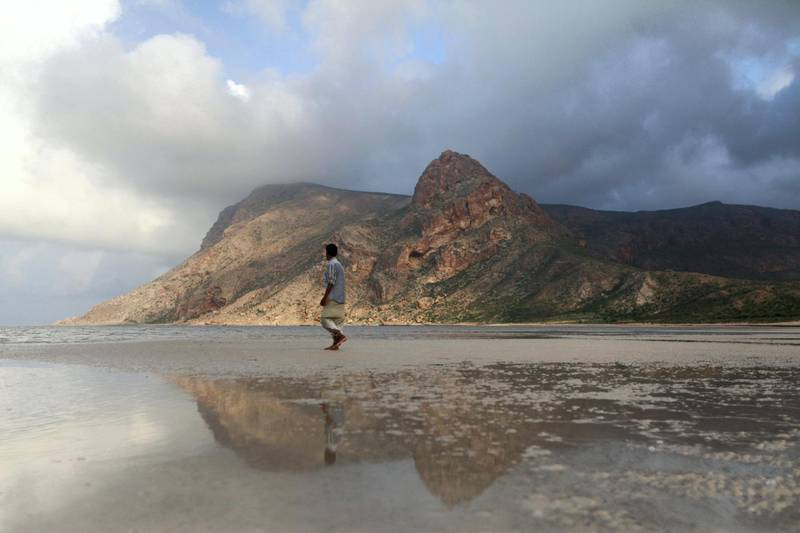 A local guide walks on the approach to Ditwa lagoon and beach near the port of Qalensiya, the second biggest town on Yemen's Socotra island November 21, 2013. The Socotra islands, in the Arabian Sea 380 km south of mainland Yemen and 80 km west of the Horn of Africa, harbour many unique species of birds and plants and gained UNESCO recognition in July 2008 as a world natural heritage site. REUTERS/Mohamed al-Sayaghi (YEMEN - Tags: TRAVEL ANIMALS) - GM1E9BM02B901