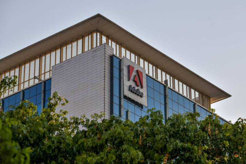 """In this photo taken on April 16, 2020, a general view shows the Indian office of US multinational computer software company Adobe in Bangalore. - Coronavirus is permanently shaking up the global outsourcing industry as lockdowns from Bangalore to Manila prompt firms to """"reshore"""" jobs and, with AI, to move further away from needing humans at all. (Photo by Manjunath Kiran / AFP) / To go with 'INDIA-HEALTH-VIRUS-COMPUTERS-BUSINESS' by Ammu Kannampilly, with Cecil MORELLA in Manila"""