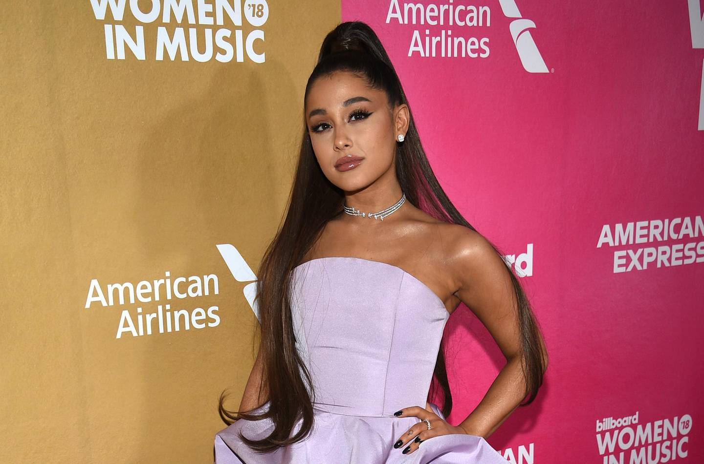 FILE - In a Thursday, Dec. 6, 2018 file photo, Ariana Grande attends the 13th annual Billboard Women in Music event at Pier 36, in New York.  Chinese tech giant Tencent is in talks with French media company Vivendi to buy 10% of Universal Music Group, whose artists include Ariana Grande, according to an announcement from Vivendi Tuesday Aug. 6, 2019.(Photo by Evan Agostini/Invision/AP, File)