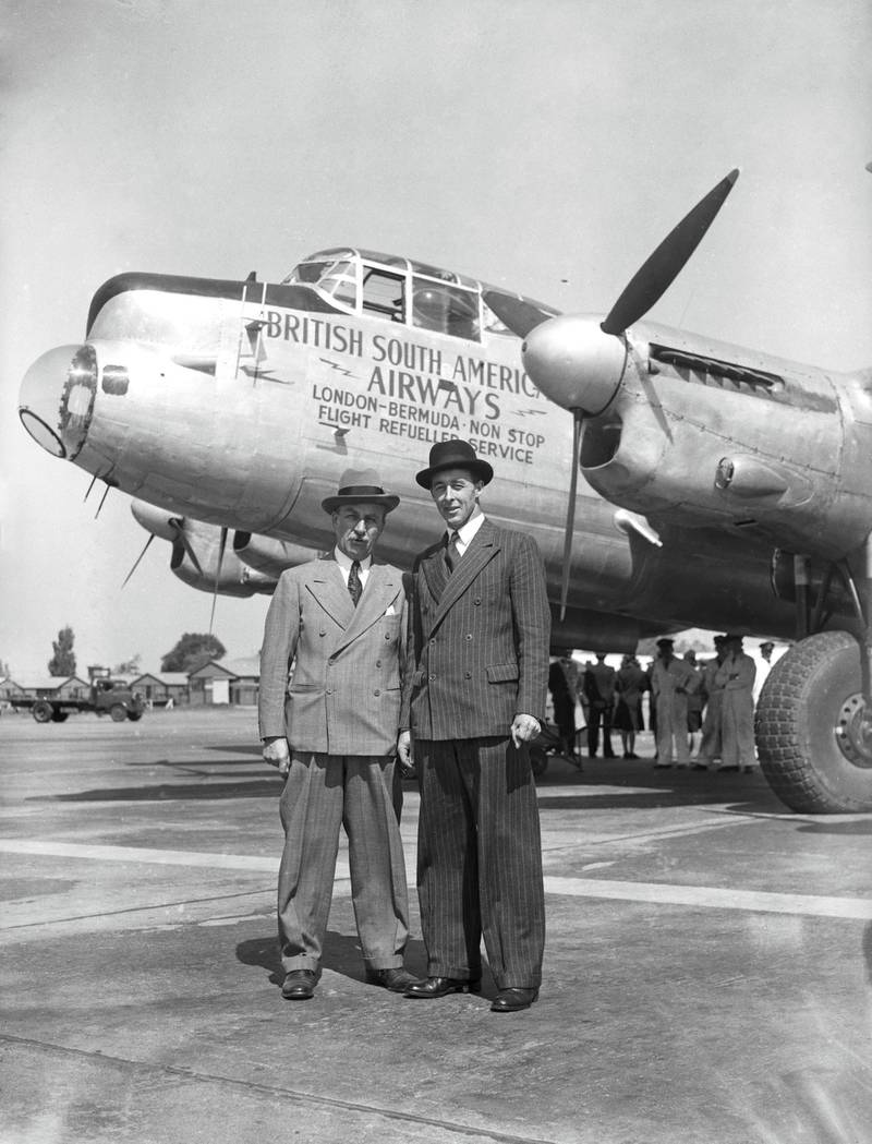 Aviation pioneer Sir Alan Cobham (1894 - 1973, left) with Air Vice Marshal Donald Clifford Tyndall Bennett (1910 - 1986), Chief Executive of British South American Airways, in front of a converted Lancaster bomber at Heathrow Airport, UK, 28th May 1947. Bennett is about to fly the aircraft non-stop to Bermuda, to test the mid-air flight refuelling system developed by Cobham before the war. (Photo by J. Wilds/Keystone/Hulton Archive/Getty Images)
