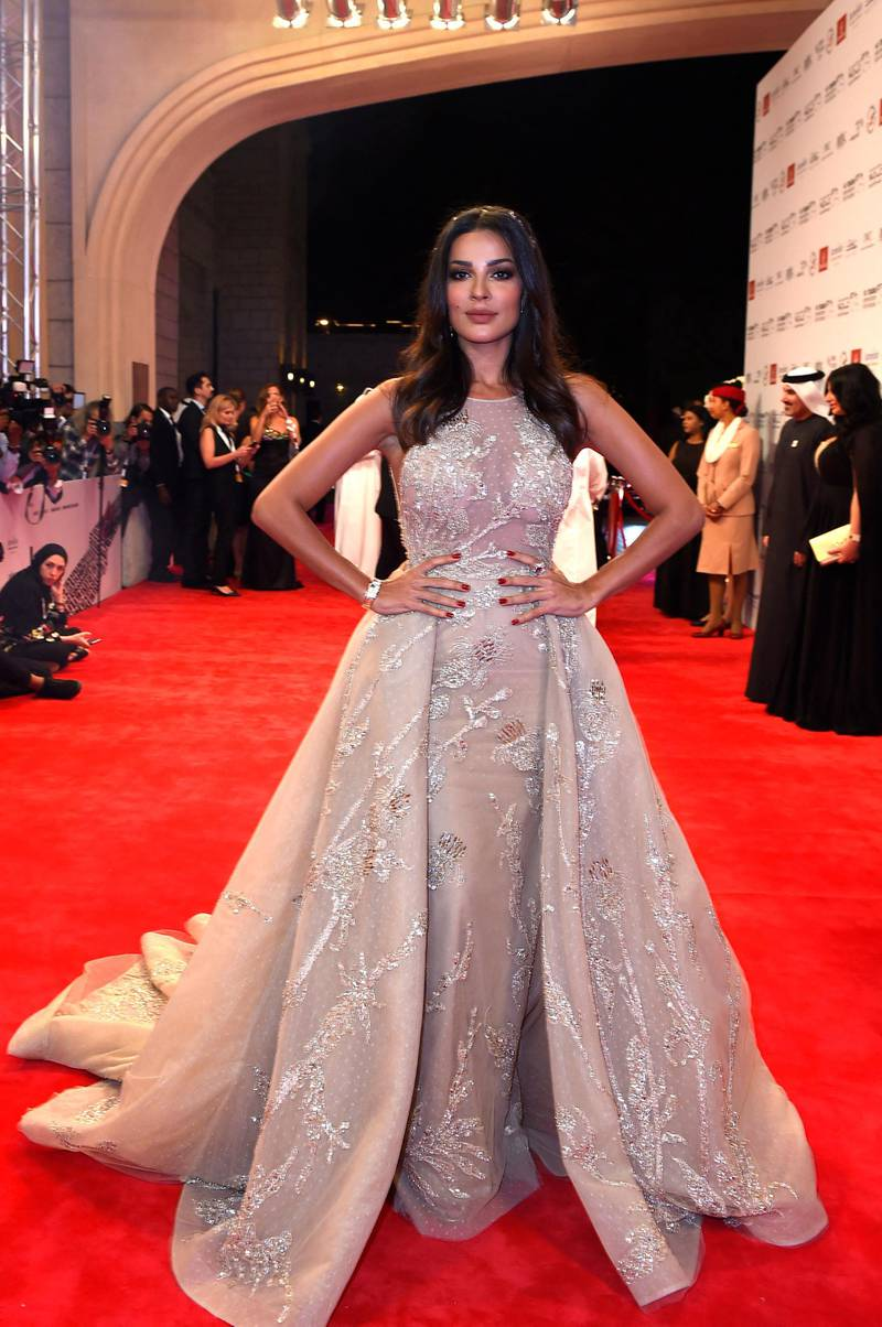 The actress, Nadine Njeim, arrives to the screening of Hostiles and to the opening ceremony of the 14th International Film Festival at Dubai, United Arab Emirates on December 6th, 2017. (Photo by AMMAR ABD RABBO / DIFF)