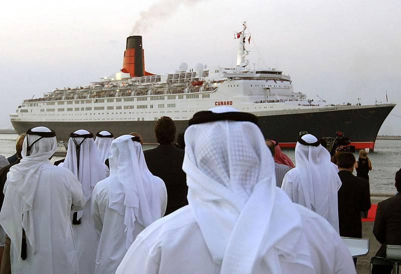 DUBAI, UNITED ARAB EMIRATES - NOVEMBER 26:  The QE2 ship arrives in Dubai from the UK on November 26, 2008.  (Randi Sokoloff / The National) *** Local Caption ***  RS016-1126-QE2crop.jpgna27no-boatspread2.jpg
