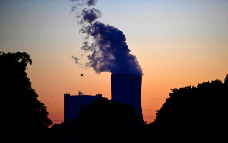 """(FILES) In this file photo taken on May 30, 2020 steam rises from the cooling tower of the coal-fired power plant Datteln 4 of Uniper in Datteln, western Germany.  The Group of Seven wealthy nations on May 21, 2021 agreed to end state financing of coal-fired power plants by the end of this year, and to """"mostly decarbonise"""" their electricity supplies in the 2030s. / AFP / Ina FASSBENDER"""