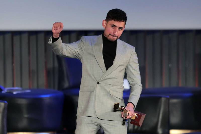 Egyptian actor Amir El-Masry receives the Golden Pyramid Award for Best Film (Limbo) at the closing ceremony of the 42nd Cairo International Film Festival (CIFF) in Cairo on December 11, 2020. / AFP / Mahmoud KHALED