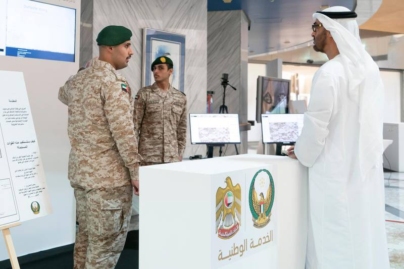 ABU DHABI, UNITED ARAB EMIRATES - April 28, 2019: HH Sheikh Mohamed bin Zayed Al Nahyan, Crown Prince of Abu Dhabi and Deputy Supreme Commander of the UAE Armed Forces (R), attends e-skills exhibition for national service recruits, at Armed Forces Officers Club. ( Rashed Al Mansoori / Ministry of Presidential Affairs ) ---